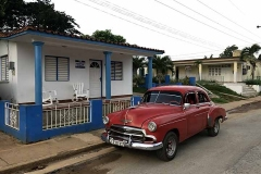 A red Chevrolet parked in Viñales